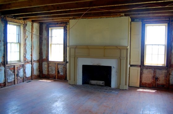fireplace inside the old farmhouse- ready for renovation