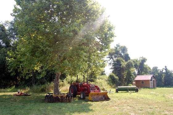 tractor resting under the tree